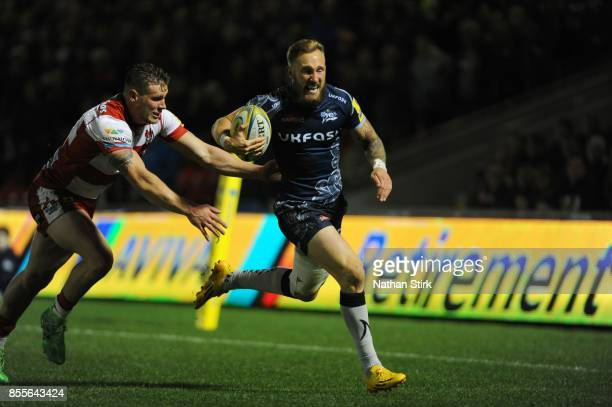 Byron McGuigan of Sale Sharks in action during the Aviva Premiership match between Sale Sharks and Gloucester Rugby at AJ Bell Stadium on September...