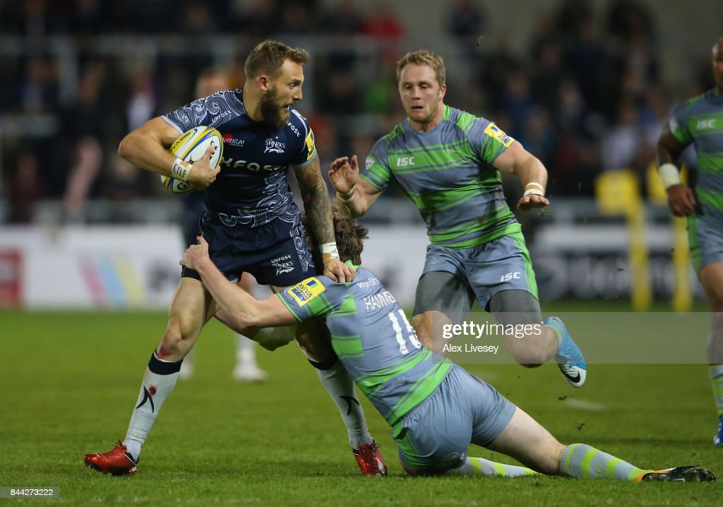 Byron McGuigan of Sale Sharks is tackled by Simon Hammersley of Newcastle Falcons during the Aviva Premiership match between Sale Sharks and Newcastle Falcons at AJ Bell Stadium on September 8, 2017 in Salford, England.