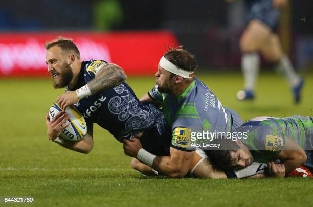 Byron McGuigan of Sale Sharks is tackled by Will Welch of Newcastle Falcons during the Aviva Premiership match between Sale Sharks and Newcastle...