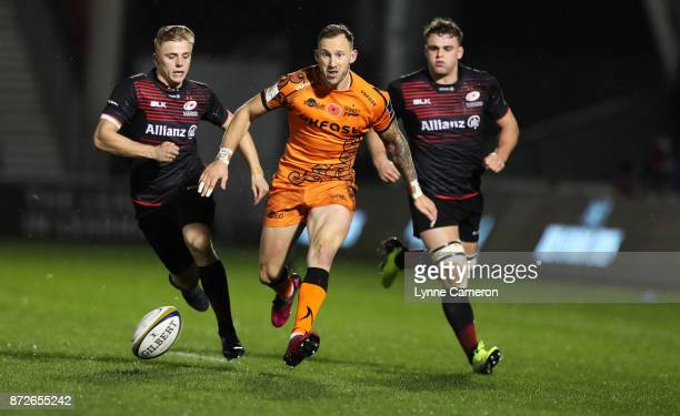Byron McGuigan of Sale Sharks runs on to his kick during the AngloWelsh Cup match between Sale Sharks and Saracens at AJ Bell Stadium on November 10...