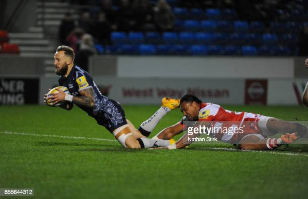 Byron McGuigan of Sale Sharks scores the second try of the game during the Aviva Premiership match between Sale Sharks and Gloucester Rugby at AJ...