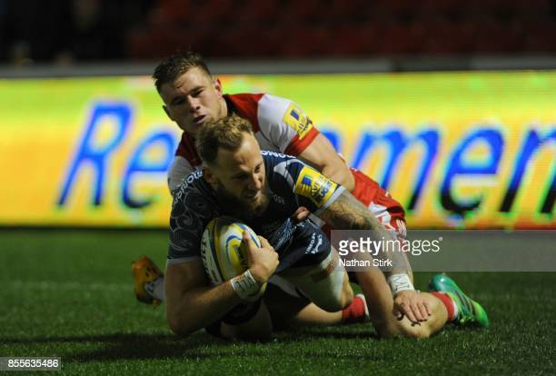 Byron McGuigan of Sale Sharks scores the third try of the game during the Aviva Premiership match between Sale Sharks and Gloucester Rugby at AJ Bell...