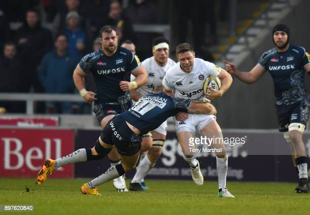 Byron McGuigan of Sale Sharks tackles Rhys Priestland of Bath Rugby during the Aviva Premiership match between Sale Sharks and Bath Rugby at AJ Bell...