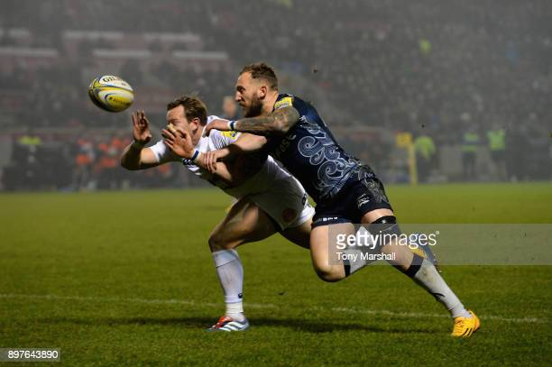 Byron McGuiganl of Sale Sharks and Jack Wilson of Bath Rugby chase a lose ball during the Aviva Premiership match between Sale Sharks and Bath Rugby...