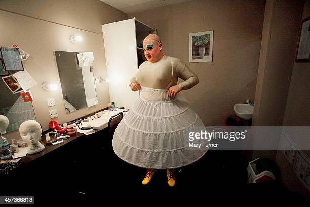 Byron Mondahl gets into his crinoline as he transforms himself into Daisy one of Cinderella's Ugly Sisters at the Churchill Theatre on December 12...