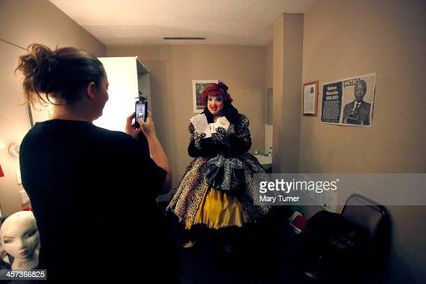 Byron Mondahl poses for a photograph after transformimg himself into Daisy one of Cinderella's Ugly Sisters at the Churchill Theatre on December 12...