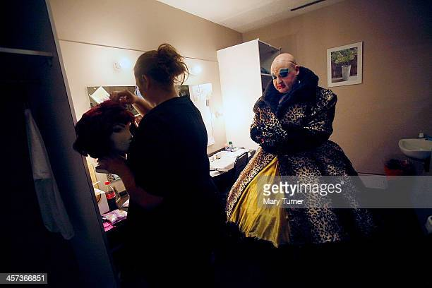 Byron Mondahl waits to be handed his auburn wig as he transforms himself into Daisy one of Cinderella's Ugly Sisters at the Churchill Theatre on...