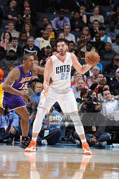 Byron Mullens of the Charlotte Bobcats controls the ball against Metta World Peace of the Los Angeles Lakers on February 8 2013 at the Time Warner...