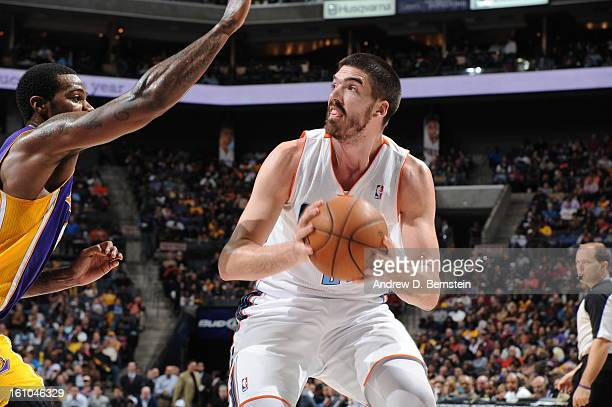 Byron Mullens of the Charlotte Bobcats looks to go to the basket against Earl Clark of the Los Angeles Lakers on February 8 2013 at the Time Warner...