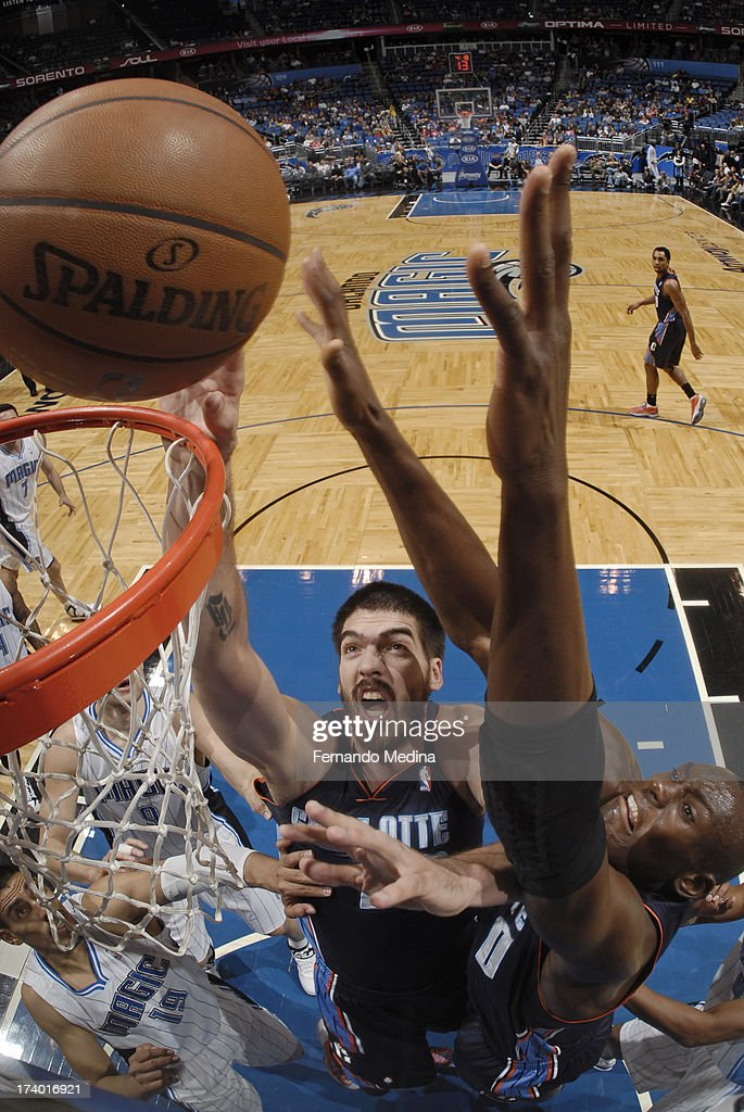 Byron Mullens #22 of the Charlotte Bobcats shoots a layup against the Orlando Magic during the game on February 19, 2013 at Amway Center in Orlando, Florida.