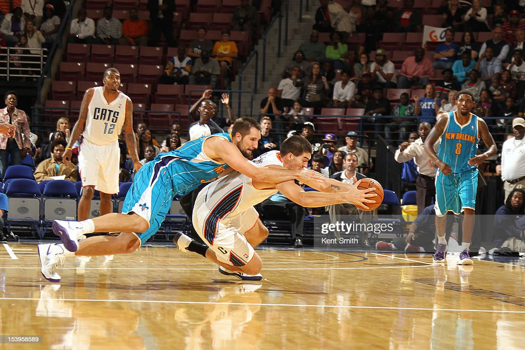 Byron Mullens #22 of the Charlotte Bobcats steals the ball from Ryan Anderson #33 of the New Orleans Hornets at the North Charleston Coliseum on October 11, 2012 in North Charleston, South Carolina.