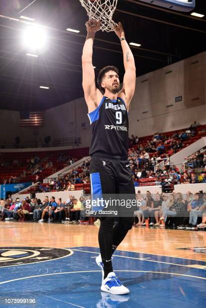 Byron Mullens of the Lakeland Magic hangs off the net during the game against the Westchester Knicks on November 10 2018 at RP Funding Center in...