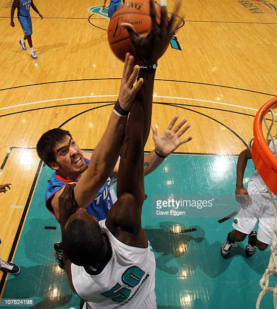Byron Mullens of the Tulsa 66ers has his shot blocked by Anwar Ferguson of the Sioux Falls Skyforce in the first half of their game December 10 2010...