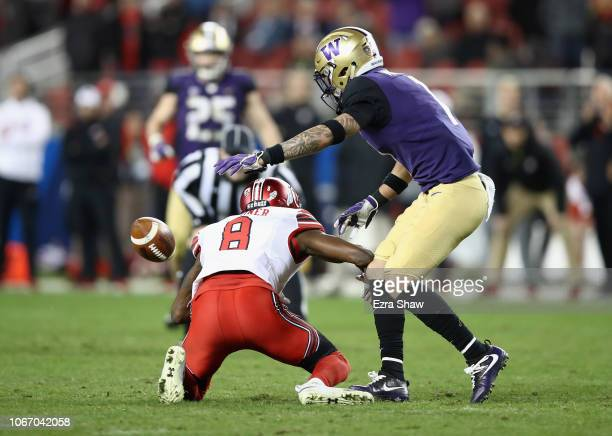 Byron Murphy of the Washington Huskies breaks up a pass intended for Siaosi Mariner of the Utah Utes to clinch the game for the Huskies late int he...