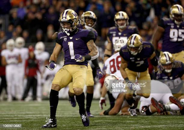 Byron Murphy of the Washington Huskies celebrates in the first quarter against the Stanford Cardinal during their game at Husky Stadium on November 3...
