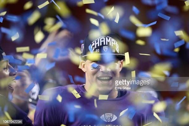 Byron Murphy of the Washington Huskies celebrates on the stage after the Huskies beat the Utah Utes to win the Pac 12 Championship game at Levi's...
