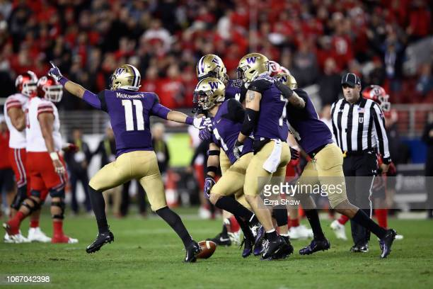 Byron Murphy of the Washington Huskies celebrates with teammates after he broke up a pass intended for Siaosi Mariner of the Utah Utes to clinch the...