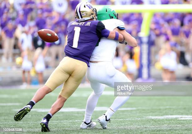 Byron Murphy of the Washington Huskies defends against Travis Toivonen of the North Dakota Fighting Sioux in the fourth quarter during their game at...