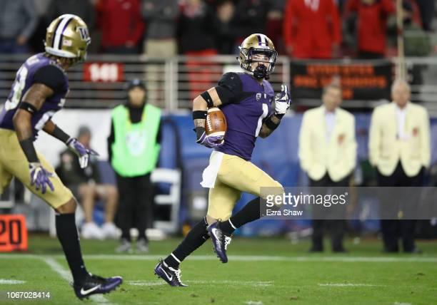 Byron Murphy of the Washington Huskies returns an interception for a touchdown against the Utah Utes during the Pac 12 Championship game at Levi's...