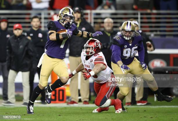 Byron Murphy of the Washington Huskies runs past Cole Fotheringham of the Utah Utes to return an interception for a touchdown during the Pac 12...