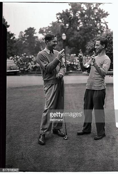 Byron Nelson of Toledo Ohio and Eddie Kirk of Framington Michigan both cross their fingers for luck in their match tomorrow against each other in the...