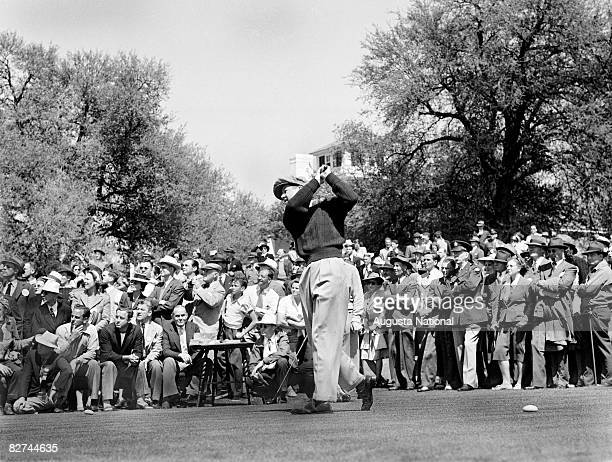 Byron Nelson plays a tee shot in front of a gallery of patrons during the 1936 Masters Tournament at Augusta National Golf Club held April 26 1936 in...