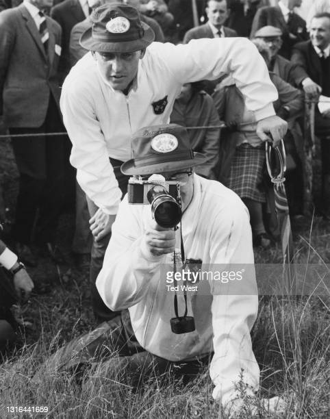 Byron Nelson , the non playing captain of the the United States Ryder Cup team uses a Asahi Pentax SV 35mm SLR camera and a 300mm lens to keep a...