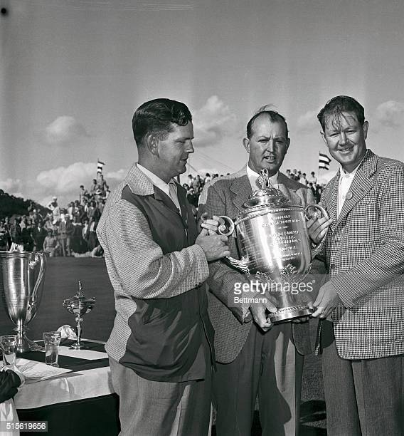 Byron Nelson winner in the National PGA Tourney at Dayton Ohio receives the huge cup from Ed Dudley PGA Tourney president as Sam Byrd runnerup looks...