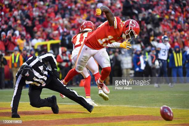 Byron Pringle of the Kansas City Chiefs collides with an official in the second half against the Tennessee Titans in the AFC Championship Game at...
