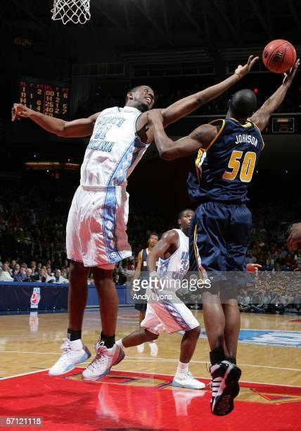 Byron Sanders of the North Carolina Tar Heels reaches for the ball against Chuck Johnson of the Murray State Racers during the First Round of the...