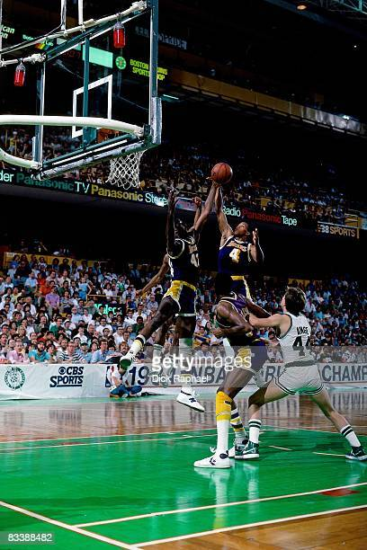 Byron Scott and James Worthy of the Los Angeles Lakers team up for a rebound against the Boston Celtics during Game Seven of the 1984 NBA Finals...