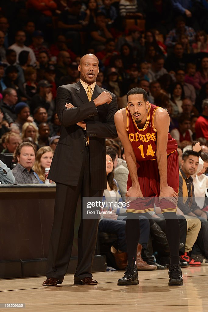 Byron Scott of the Cleveland Cavaliers and Shaun Livingston during the game against the Toronto Raptors on March 10, 2013 at the Air Canada Centre in Toronto, Ontario, Canada.