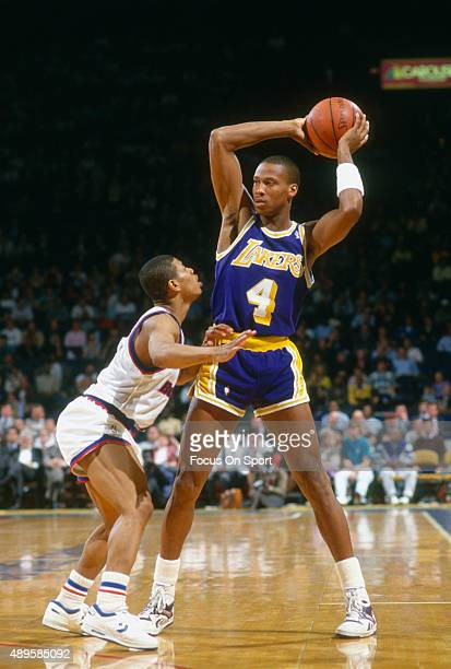 Byron Scott of the Los Angeles Lakers looks to pass over the top of Muggsy Bogues of the Washington Bullets during an NBA basketball game circa 1987...