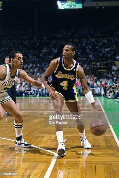 Byron Scott of the Los Angeles Lakers moves the ball up court against Dennis Johnson of the Boston Celtics during the 1987 NBA Finals at the Boston...