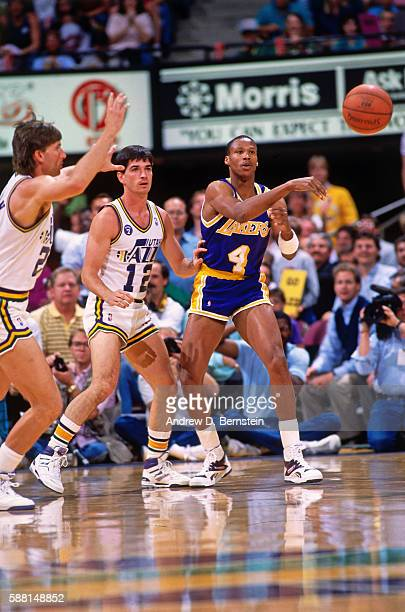 Byron Scott of the Los Angeles Lakers passes the ball against the Utah Jazz during a game in the 1988 Western Conference Semifinals at the Salt...