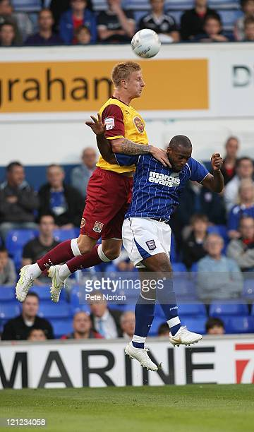 Byron Webster of Northampton Town rises above Nathan Ellington of Ipswich Town to head the ball during the Carling Cup First Round Match between...
