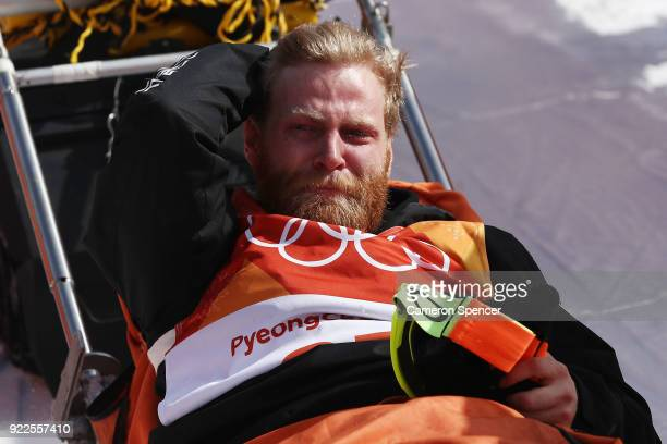 Byron Wells of New Zealand is stretched off by medical staff after crashing in training ahead of the Freestyle Skiing Men's Ski Halfpipe Final on day...