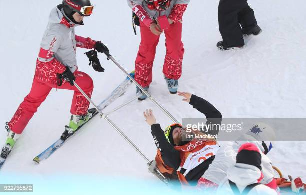 Byron Wells of New Zealand receives medical assistance after falling in practice during the Men's Ski Halfpipe final on day thirteen at Phoenix Snow...