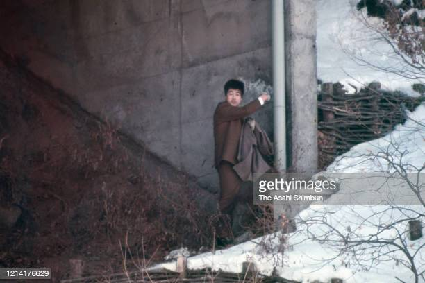 A bystander approaches to the Asama Sanso lodge where the United Red Army members take a hostage after sneaking through the police cordon on February...