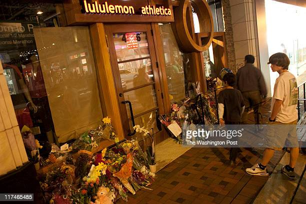 A bystander looks at the flowers left for Lululemon employee Jayna Murray who was killed allegedly by her coworker Friends and the community have a...