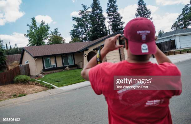 A bystander takes a photo of the home of Joseph James DeAngelo the suspected Golden State Killer