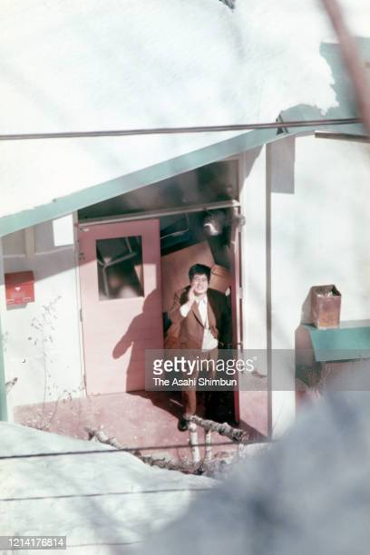 A bystander talks with riot police at the entrance of the Asama Sanso lodge where the United Red Army members take a hostage after sneaking through...