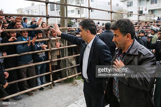 Bystanders applaud Abdolghani Hosseinzadeh the father of Abdolah an Iranian youth killed by fellow national Balal in a street fight with a knife in...
