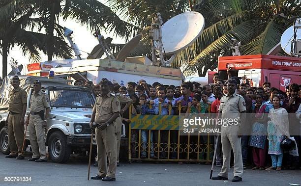 Bystanders are corralled by police officials as they stand outside the home of Indian Bollywood actor Salman Khan in Mumbai on December 10 after he...