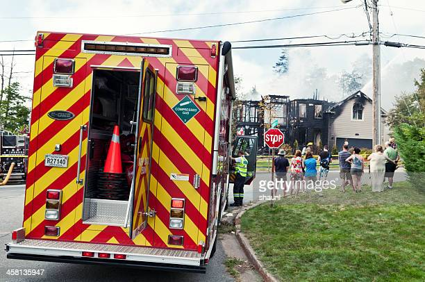 bystanders at house fire - incidental people stock pictures, royalty-free photos & images