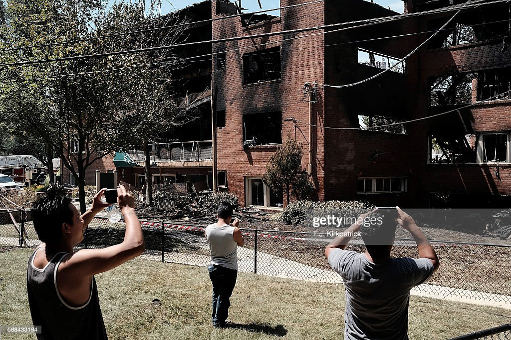 Natural gas explosion and fire levels apartments in dc suburb bystanders take photos after an overnight explosion and fire destroyed an apartment building in the flower mightylinksfo