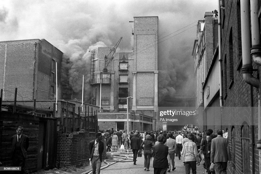 Bystanders watch as firemen still work on the disused cold storage depot at Willsonu0027s Wharf & Disasters and Accidents - Tooley Street Fire - London Pictures ...