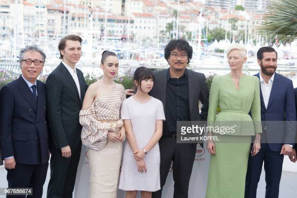 Byung Heebong Paul Dano Lily Collins director Bong JoonHo actors Tilda Swinton and Jake Gyllenhaal attend the 'Okja' photocall during the 70th annual...
