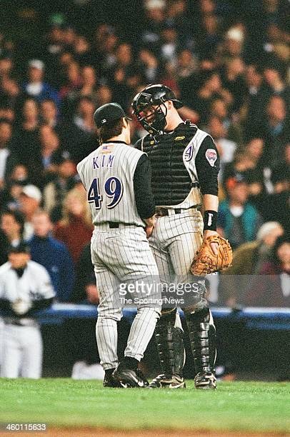 ByungHyun Kim and Damian Miller of the Arizona Diamondbacks talk during Game Four of the World Series against the New York Yankees on October 31 2001...