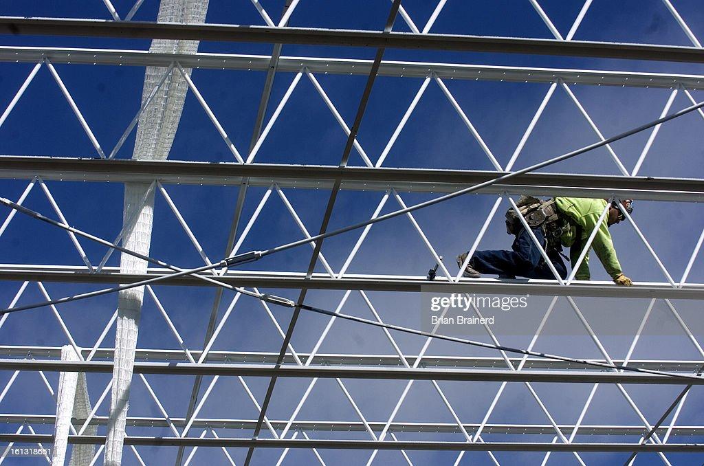 ml) bz10sheridan_bb_5 -- A construction worker climbs across steel ...